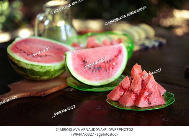 Watermelon, Citrulus lanatus, Outdoor shot of sliced fruit showing red flesh and seed,----