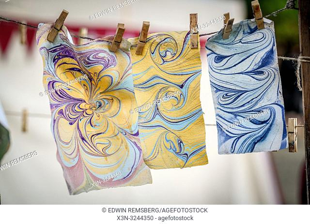 Marbled paper hung with clothes pins to dry at annual St John's Fair - Jarmark -, Kraków, Lesser Poland Voivodeship, Poland