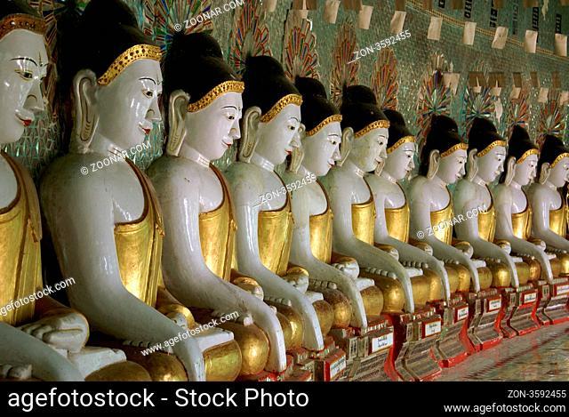 Buddhas and wall of buddhist temple, Sagaing hill, Mandalay, Myanmar