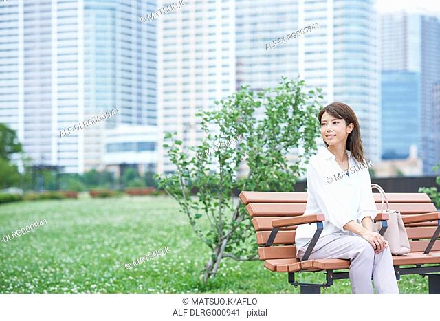 Portrait of young Japanese woman in a city park, Tokyo, Japan