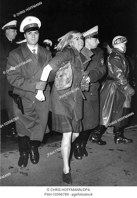 Policemen arrest a female demonstrator on the 17th of December in 1966 in Berlin, because she refused to accept the police's orders. - Berlin/Germany