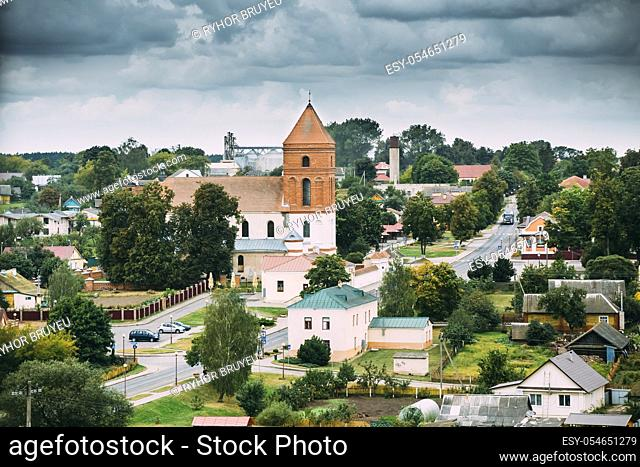 Mir, Belarus. Landscape Of Village Houses And Saint Nicolas Roman Catholic Church In Mir, Belarus. Famous Landmark
