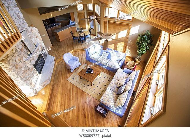 View of living room and dining room from loft