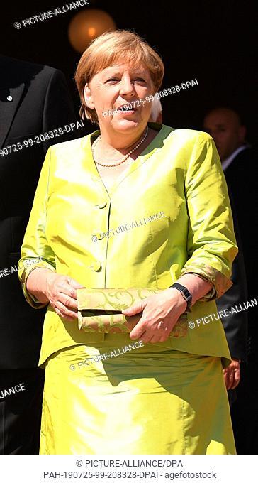25 July 2019, Bavaria, Bayreuth: Chancellor Angela Merkel (CDU) arrives at the beginning of the Bayreuth Festival 2019. The Richard Wagner Festival begins in...