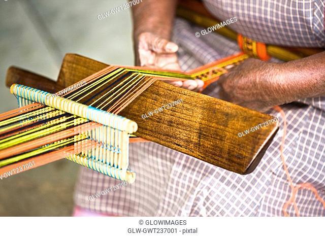 Mid section view of a woman weaving textile, Santo Tomas Jalieza, Oaxaca State, Mexico