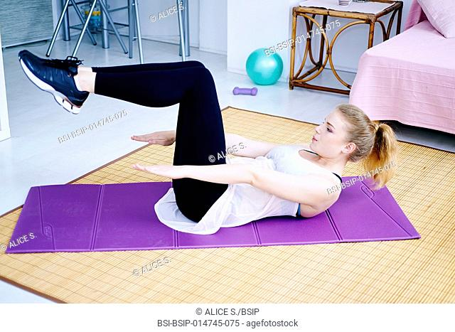 Woman practicing sport at home