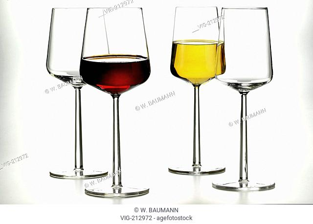 Four wine glasses, one filled with red, another with white wine. - 01/01/2006