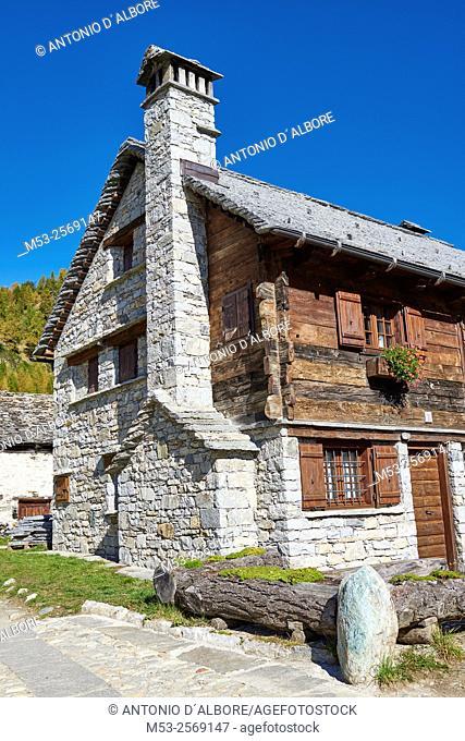 A mountain cottage made of stone bricks. Alpe Campriolo alpine village. Municipality of Baceno. Province of Verbano-Cusio-Ossola. Piedmont. Italy