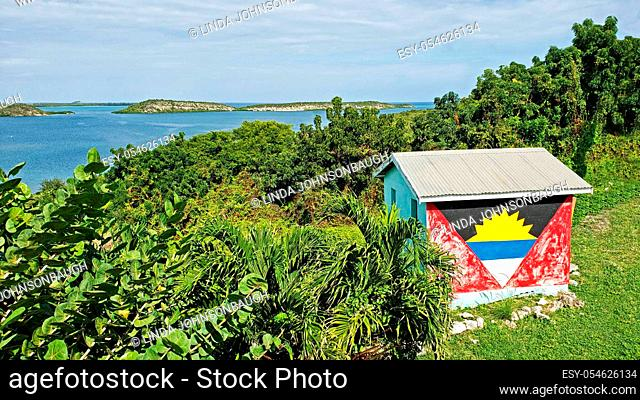 Shed painted with the Antigua Flag overlooking Mercer Creek Bay, Seatons, Antigua Barbuda Lesser Antilles, West Indies, Caribbean