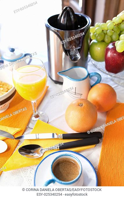 Mediterranean breakfast with coffee, grapefruit juice, fruits