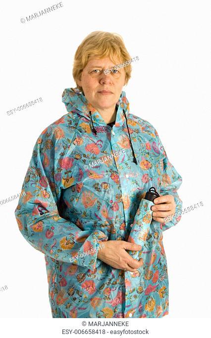 Elderly woman with rain coat holding an umbrella