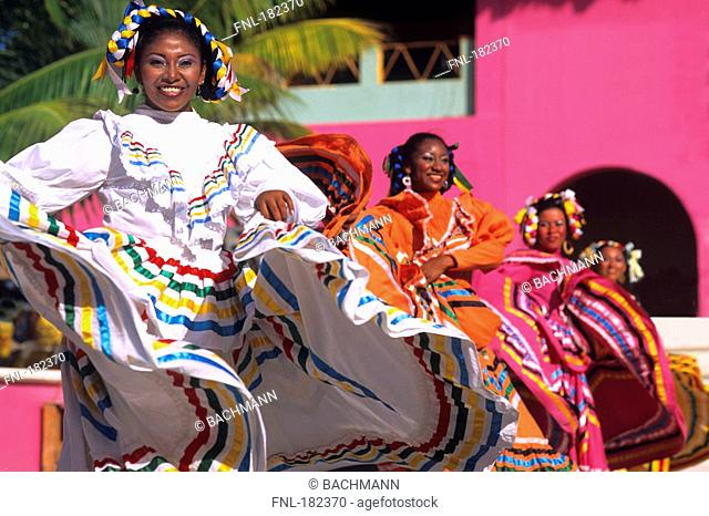 Teenage girls dancing in traditional dress, Mexico