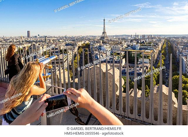 France, Paris, tourists on the terrace of the Arc de Triomphe and the Eiffel Tower