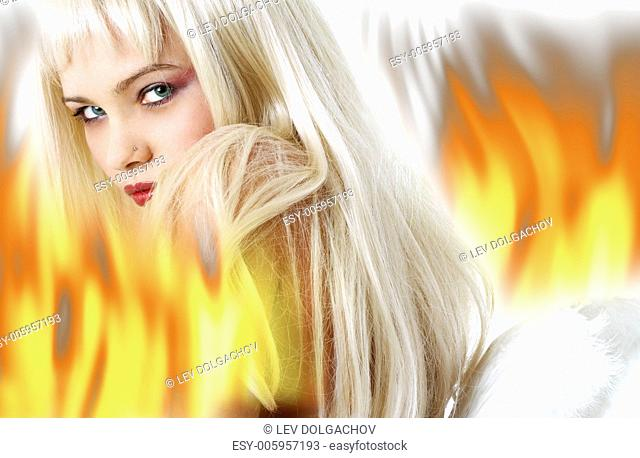 lovely blond with angel wings surrounded by fire