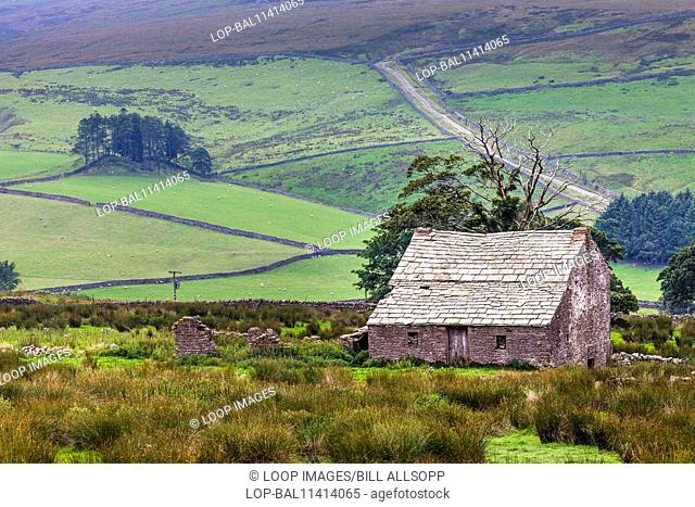 Derelict farmhouse and barn in moorland