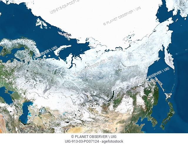 Satellite view of Russia and Central Asia in winter, with partial snow cover and Arctic ice cap (with country boundaries)