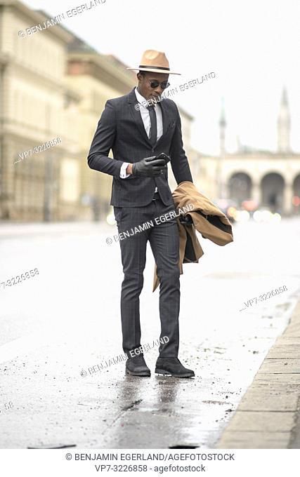 Fashionable man walking on the street. Munich, Germany