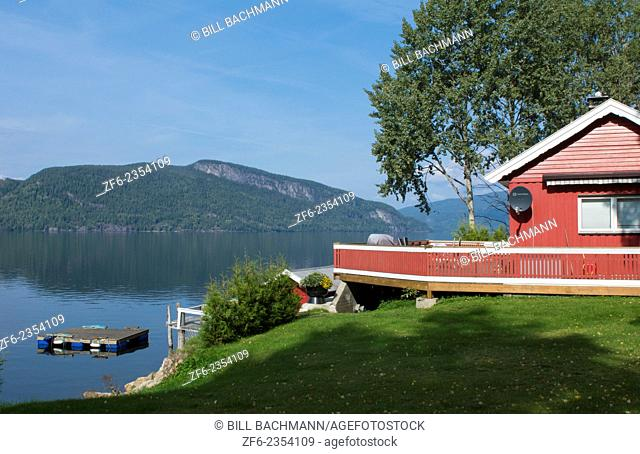 Nes Norway red vacation home on water in beautiful setting