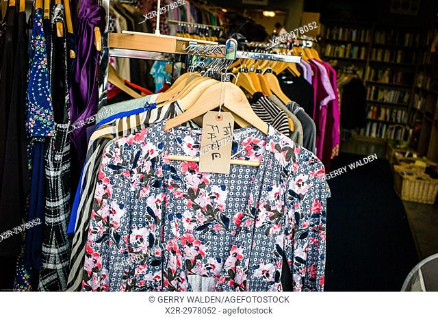 A Fat Face label adorns an extra small item in a charity thrift shop, Bath, England