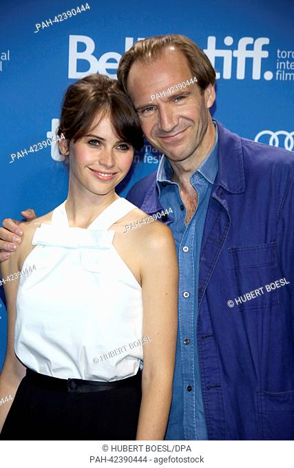 """Director Ralph Fiennes and actress Felicity Jones attend the photo call before the press conference of """"""""The Invisible Woman"""""""" during the 38th annual Toronto..."""
