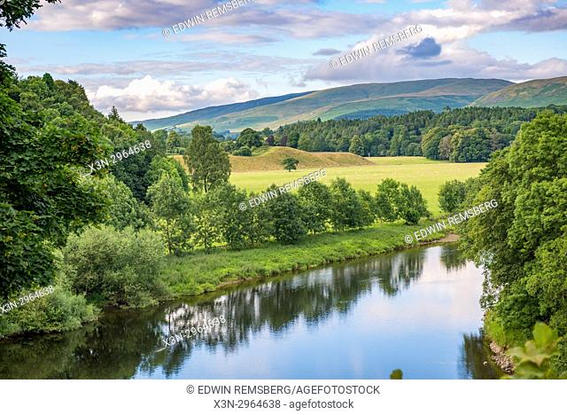 Clouds roll over the lush green hills overlooking a river, Kirkby Longsdale, Cumbria, England. The view of the River Lune from the churchyard in Kirkby Lonsdale...