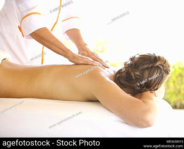 Rear view of woman receiving massage therapy at a luxury resort and spa in Napa Valley California