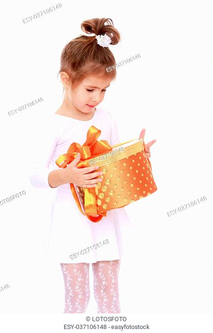 Lovely little girl in a short white dress, holding a round box which is a Christmas gift. Closeup-Isolated on white background