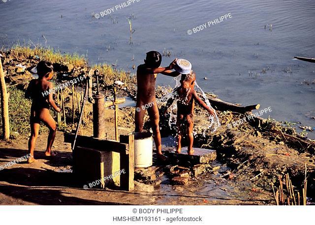 Myanmar Burma, Mandalay Division, Amarapura old city, children washing