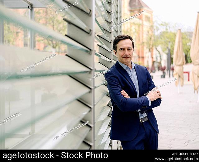 Portrait of a confident mature businessman in the city