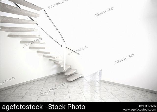 twisted staircase in clean white building leading up to second floor with white walls and doors