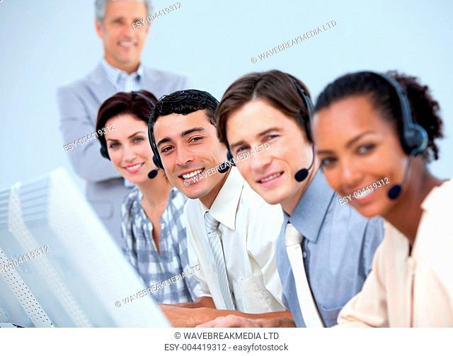 Cheerful business partners working in a call center