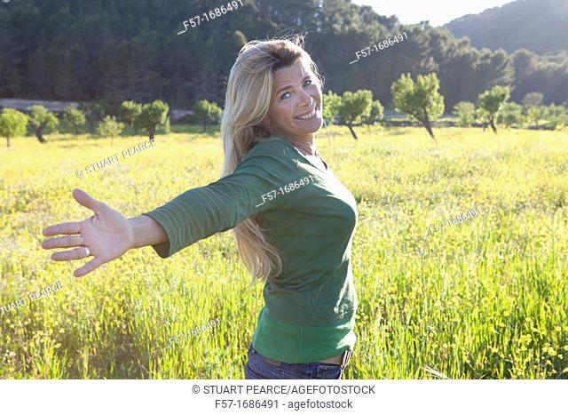 Forty something year old woman in a meadow