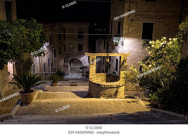 Corinaldo (Ancona, Marches, Italy): the historic town at evening. Well
