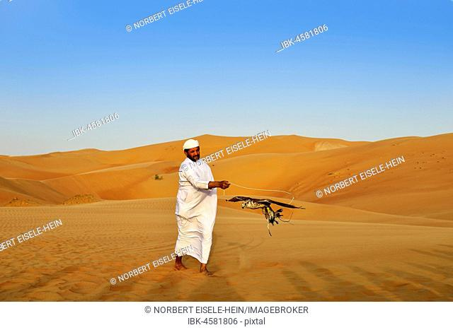 Falconer in the desert luxury hotel Anantara Qasr Al Sarab, in the middle of high sand dunes, in the Empty Quarter called sand desert Rub Al Khali