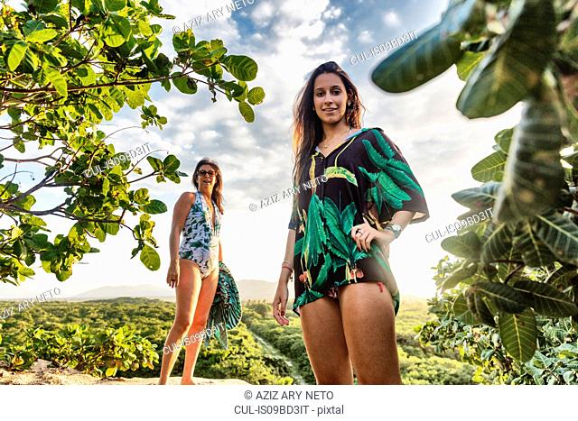 Portrait of mother and daughter in swimwear looking at camera smiling, Caucaia, Ceara, Brazil
