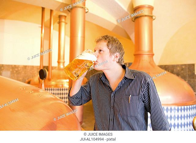 Brewer drinking beer at brewery in Traunstein, Bavaria, Germany