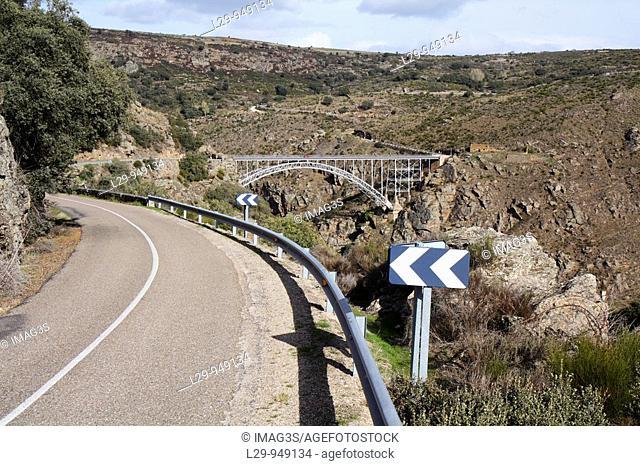 ZA-321 road and Requejo bridge (Puente Pino) over Douro river, built in 1914. Arribes del Duero Natural Park, Zamora province, Spain