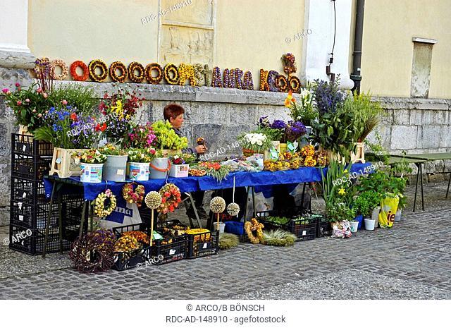 Flower vendor stall at cathedral St Nikolaus Ljubljana Slovenia