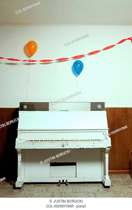 Piano and party balloons