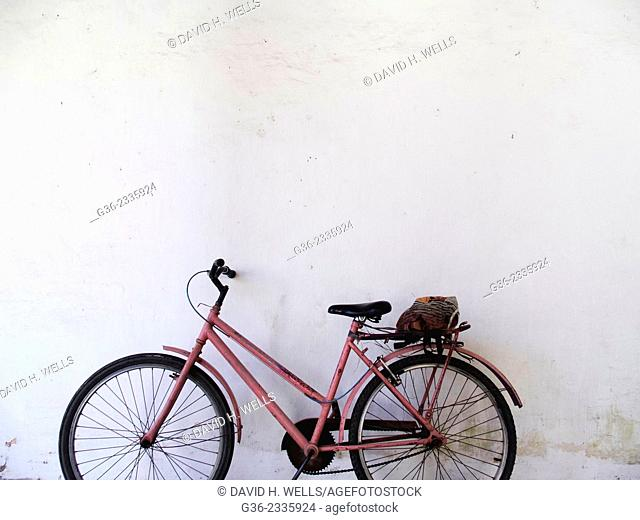Bicycle parked in front of a wall, Vitoria, Espirito Santo, Brazil