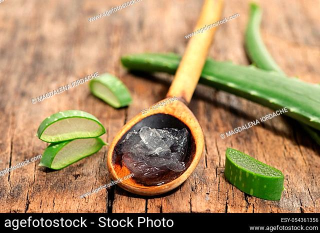 Aloe Vera Slices On Wooden Table And Spoon With Aloe Gel