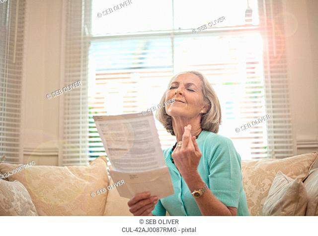 Older woman reading on sofa