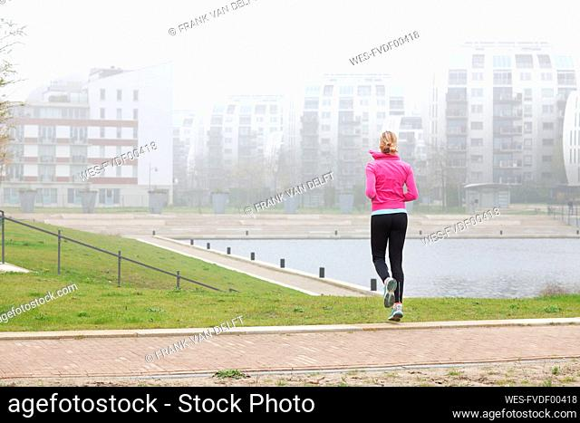 Woman exercising while jogging at park
