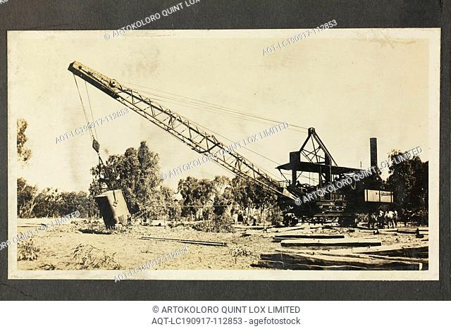 Photograph - A.T. Harman & Sons, Group Surrounding an Excavator, Victoria, circa 1923, One of five black and white photographs attached to an album page