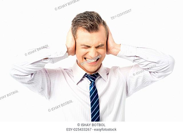 Frustrated man covering his ears with hands