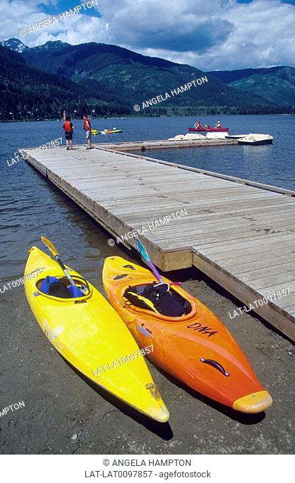Garibaldi Point. Near Whistler. Beach. Boat hire. Canoes. People in life vests,jackets