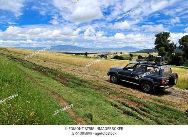 Toyota Landcruiser on a dirt track in the highlands of Bale Mountains, Oromia, Ethiopia, Africa