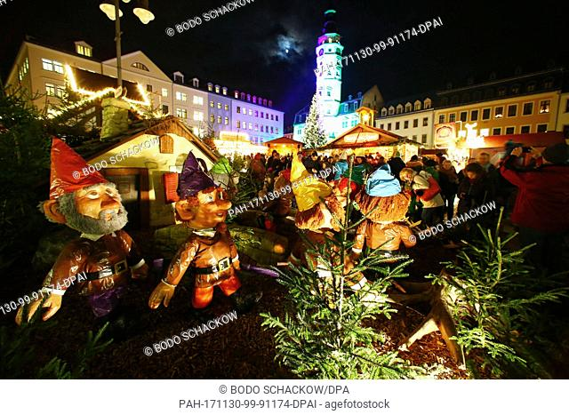 Visitors walk across the Christmas market during the opening of the 'Gera Fairy Tale Market' in Gera, Germany, 30 November 2017