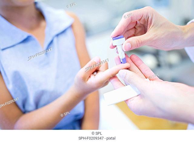 Doctor giving girl a finger prick test