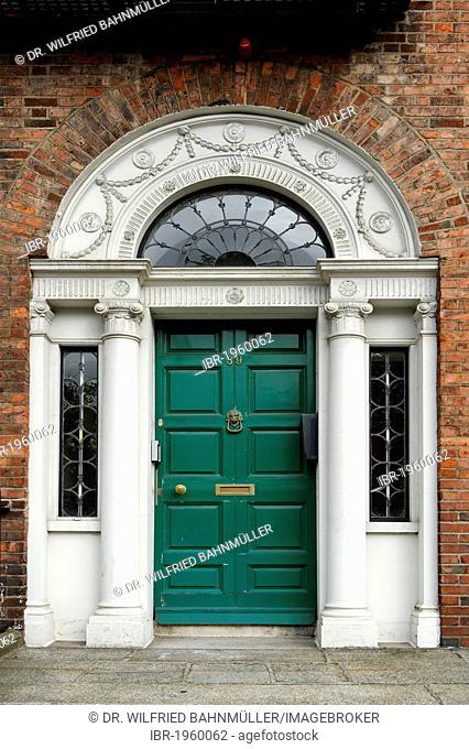 Green front door of a terraced house near Merrion Park, Dublin, Republic of Ireland, Europe